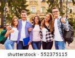 portrait of group of happy... | Shutterstock . vector #552375115