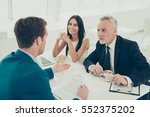 two happy colleagues on meeting ... | Shutterstock . vector #552375202