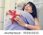 wife hugging husband for the... | Shutterstock . vector #552413212