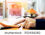businessman holding paper home... | Shutterstock . vector #552436282