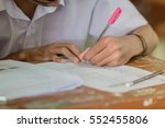 students writing test exam on... | Shutterstock . vector #552455806