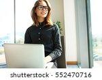 hipster girl use laptop huge... | Shutterstock . vector #552470716