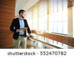 working on new tablet. low... | Shutterstock . vector #552470782