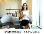 businesswoman drinking coffee... | Shutterstock . vector #552470818