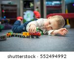 child boy play with wooden... | Shutterstock . vector #552494992