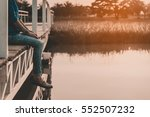 girl on a bridge on the sunset... | Shutterstock . vector #552507232