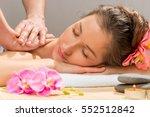 masseur's hands doing massage... | Shutterstock . vector #552512842