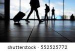 travellers in airport walking...   Shutterstock . vector #552525772