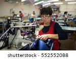 worker in textile industry... | Shutterstock . vector #552552088