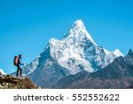 hiker with backpacks reaches... | Shutterstock . vector #552552622