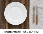empty plate and cutlery on the... | Shutterstock . vector #552564442