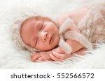 a newborn baby in a knit cap... | Shutterstock . vector #552566572