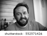 cheerful mature bearded man.... | Shutterstock . vector #552571426