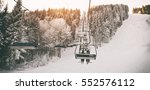 people are lifting on ski lift... | Shutterstock . vector #552576112