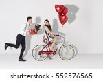 happy couple with gift and... | Shutterstock . vector #552576565