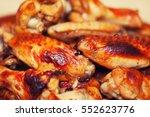 juicy chicken wings on a clay... | Shutterstock . vector #552623776