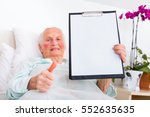 Happy Elderly Woman Holding He...