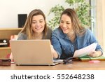 two students studying together... | Shutterstock . vector #552648238