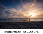man walking on the sea shore at ... | Shutterstock . vector #552655276