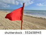 A Red Warning Flag On The Beac...