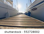 marina with anchored boats.... | Shutterstock . vector #552728002