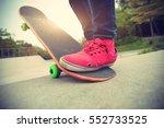 young skateboarder legs riding... | Shutterstock . vector #552733525