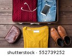 open suitcase with casual... | Shutterstock . vector #552739252