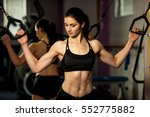 beautiful fit woman works out... | Shutterstock . vector #552775882