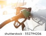 grey car at gas station being... | Shutterstock . vector #552794206