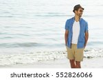laughing beach guy in shorts... | Shutterstock . vector #552826066