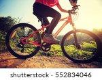 young woman riding mountain... | Shutterstock . vector #552834046