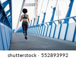 young athletic woman jogger... | Shutterstock . vector #552893992
