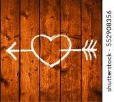 white shape heart pierced by an ... | Shutterstock .eps vector #552908356