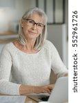 senior woman at home websurfing ... | Shutterstock . vector #552961726