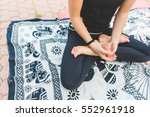 close up on the hands of young... | Shutterstock . vector #552961918
