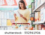 young woman doing grocery... | Shutterstock . vector #552961936