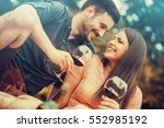 cute young couple drinking red... | Shutterstock . vector #552985192