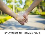 two lovers holding hands in the ... | Shutterstock . vector #552987076