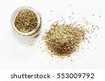 oregano in glass jar. heap.... | Shutterstock . vector #553009792