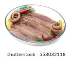 Stock photo fillets of herring anchovies in glass plate white background 553032118