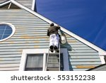 a contractor or painter on a... | Shutterstock . vector #553152238