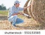 Farmer Checking A Hay Bale...
