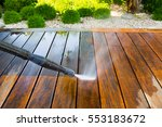 cleaning terrace with a power... | Shutterstock . vector #553183672