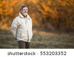portrait of a senior man... | Shutterstock . vector #553203352