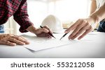 architects engineer discussing... | Shutterstock . vector #553212058