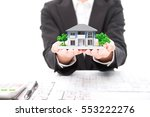 real estate agent with house... | Shutterstock . vector #553222276