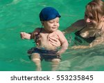 beautiful young mother with son ... | Shutterstock . vector #553235845
