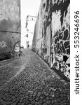 Small photo of narrow cobblestone alleyway of european country