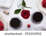 Stock photo  glasses of red wine on a red and white table setting top view 553253902