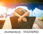 Summer day lifestyle woman relax and chill near luxury swimming pool sunbath at the beach resort outdoors the hotel.  Vacations and Summer Concept - stock photo